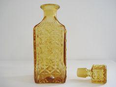 antiguidade garrafa antiga vidro bico de jaca na cor âmbar