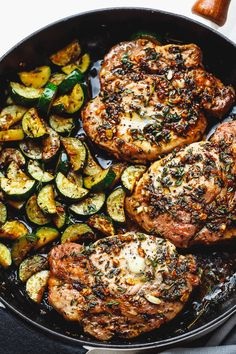 Garlic Butter Herb Pork Chops with Zucchini - This complete Paleo meal is quick, easy and effortless!