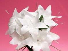Many brides opt out of real flowers for their wedding because of cost purposes. If you're on a tight budget and have a quick turnaround - these White Tiger Lilies are a gorgeous pick! http://www.efavormart.com/tiger-lily-white.aspx