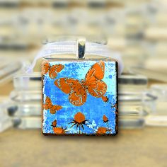 Blue & Orange Butterfly Pendant necklace  by glitteringdreams