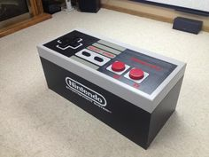 DIY working Nintendo remote control coffee table! Some people also added decals to the bottom - http://stuffmenlike.com/wp-content/uploads/2012/12/diy-nintendo-coffee-table.jpg
