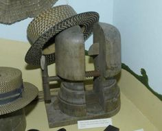 Victorian straw hat and wooden hat block.