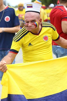 A fan of Colombia cheers for his team prior a match between Colombia and…