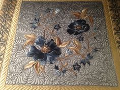 Karen McTavish. OMG. I have this set of embroidery designs but my quilting was not like this. Got to give it a go.