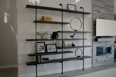 Who needs art with shelves like this? This custom pipe shelf has a weathered look and is fully customizable to fit your unique space. Pipe Shelves, Conference Table, Custom Furniture, Office Furniture, Commercial, Inspiration, Accessories, Home Decor, Style