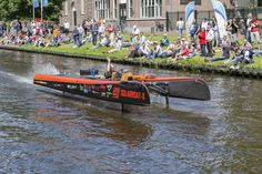 The audience is watching SDOG Racing Team during the Dutch Solar Challenge 2014. They raced in the top class at the world cup for solar powered boats.