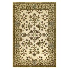 Hand-tufted wool rug with a Persian-inspired floral motif.   Product: RugConstruction Material: 100% Wool