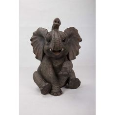 Hi-Line Gift Ltd. Sitting elephant baby statue is an adorable life like replica gigantic animal baby. Made with polyresin this statue is good for both indoors and outdoors. Makes an adorable gift for the loved ones. Elephant Trunk Up, Grey Elephant, Elephant Art, Elephant Tattoos, Giraffe, Elephants, Elephant Jewelry, Baby Elefant, Bone Crafts