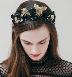 Show them who is Queen Bee. A swarm of crystal pavé bees and cicada alight on handpainted black enamel flowers with jet Swarovski crystal centers to create this stunning tiara. All Jennifer Behr hair accessories and headbands are handmade in New York City.  We ship worldwide! Orders ship within 3-5 business days. Please email shop@jenniferbehr.com or call 718-360-1875 to request expedited shipping. We are a small team and are happy to answer your questions 10am - 6pm, Monday - Friday :)…
