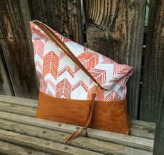 Genuine Leather // Arrow Fabric // Clutch by indigosoulcompany on Etsy