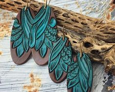 Check out our leather earrings tooled selection for the very best in unique or custom, handmade pieces from our shops. Leather Jewelry Making, Diy Leather Earrings, Wood Earrings, Diy Earrings, Custom Leather Bracelets, Leather Accessories, Accessories Jewellery, Jewelry Crafts, Handmade Jewelry