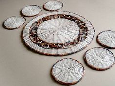 Baskets woven from recycled paper.   More photos here: http://blureco.blogspot.co.uk/2013/11/ze-smieci-na-smieci.html