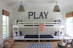This kids' bunk room reminds me of a beach house.  All four children sleeping against one wall frees up so much space.