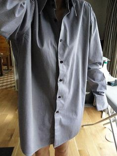 This is the tutorial I was looking for.     jltfk: How to tailor a shirt (Refashion a men's shirt to fit a woman)