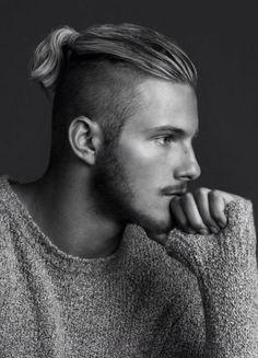 Undercut, ponytail.   Alexander Ludwig