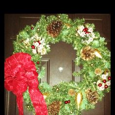My DIY wreath!! Bought each piece and put it together. Just takes hot glue. Looks beautiful on the front door!