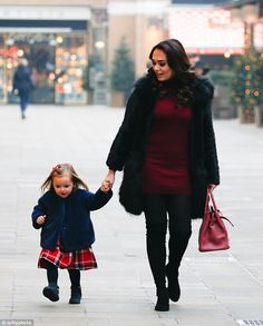 Keeping warm: Tamara and Sophia got all bundled up in cosy winter fashions for their visit...