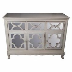 "Bring classic appeal to your entryway or living room with this mirrored 3-drawer chest, featuring quatrefoil overlays and a scalloped bib.    Product: ChestConstruction Material: Mirrored glass and woodColor: NaturalFeatures:  Three drawersThree doorsQuatrefoil overlays Scalloped bibDimensions: 47"" H x 35"" W x 16"" D"