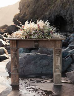 Whimsical boho mantle with a floral centerpiece