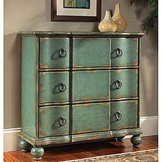 Purchased this, love the color. Will look great in my foyer.@Overstock - Hand-painted chest features a pale blue distressed finishLiving room furniture is constructed of hardwood and MDFAccent chest has antique brass finish hardwarehttp://www.overstock.com/Home-Garden/Hand-painted-Distressed-Blue-Accent-Chest/3928245/product.html?CID=214117 $478.99