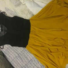 Date night Sexy and sweet. Sheer top with layers of yellow chiffon. Very small pull on skirt as shown in pic. Not noticeable with layers. Ark & Co Dresses High Low