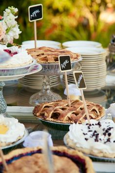 An assortment of pies makes a great wedding dessert table at this shabby chic wedding. {A. Blake Photography}