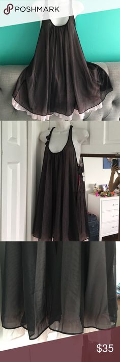 Betsey Johnson chemise Sz M & L Cute & flrty Betsey Johnson chemise . This is a 2 layer piece. Outside layer is black and inside layer is a soft baby pink . Cute bow in the front and back . Betsey Johnson Intimates & Sleepwear Chemises & Slips