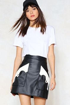 We've got the most wanted right here. The Call the Sheriff Skirt comes in vegan leather and features a mini, A-line silhouette, two oversized pockets at front with contrast pattern, and zip closure at back.
