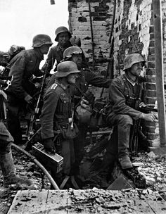 German infantry, caught in the ruins of Stalingrad, fight an unwinnable battle. Note the platoon machine gunner with the MG-36, Sept 1942.