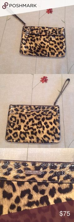 Kate Spade Patent Leather Leopard Wristlet Gorgeous patent leather Kate Spade wristlet...never been used and in perfect condition.  Dimensions are 6 inches high and 8 inches across.  Wrist strap is 5.5 inches.  It's truly adorable! kate spade Bags Clutches & Wristlets