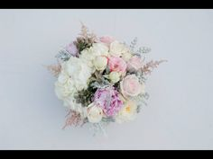 Wedding Centerpiece by Root Floral Design Photo by Heirloom Collective  From Lafayette, La & New Orleans, La  Hydrangeas, peonies, garden roses, astilbe, dusty miller, silver brunia, wedding flowers, light pink, ivory, mint, grey