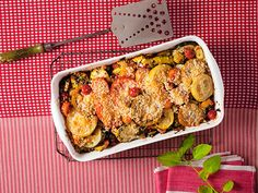 Fresh summer vegetables, fragrant basil, and savory Parmesan come together beautifully in this brilliant casserole dish.