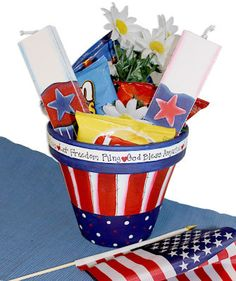 red, white, and blue patriotic pot  uses acrylic paint  looks perfect for party stuffers!