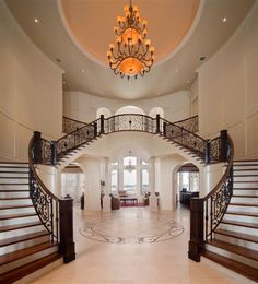 Ravelais: French Castle luxury home design by John Henry, Architect -- Luxury house with a grand foyer and double staircase Luxury Homes Interior, Home Interior Design, French Interior, Mansion Interior, Luxury Decor, French Decor, Scandinavian Interior, Interior Ideas, Interior Decorating