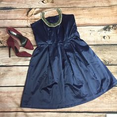 Navy Strapless Dress This dress is so fun to wear. It's 30 inches long with a 14 1/2 inch waist. It's has a 14 inch zipper on the back and is fully lined. It is strapless but it does have plastic boning to help keep it up and in place, it also has 3 pleats on the front and the back. Just add some sparkley accessories and you'll absolute feel like a princess. Merona Dresses Strapless