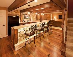 A little light for my tastes, but great stone work, under bar lighting and wood beams.