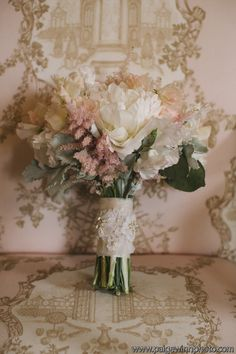 Delicate blush bouquet with peonies, sweet peas, astilbe and dusty miller.
