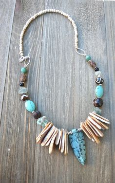 Green turquoise jasper stone arrowhead pendant, stone, wood, shell and indonesian glass, silver metal necklace.