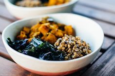 hearty fall bowl with curry roasted vegetables, lentils, wheatberries, and massaged kale in a spicy maple dijon dressing