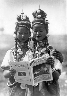 Myanmar ~ Shan State | Padaung girls reading Amataur Photographer.  ca. 1930 |  An example of Colonel Green's staged photographs.