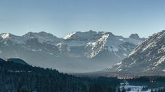 Banff Winter Morning - The icy light of a winter morning in the mountains spreads across the valley, warming and dissipating the verdant shadows of the dense evergreen forests.