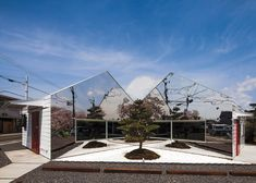 Bandesign clads a Japanese cafe in mirrors to reflect a row of cherry trees