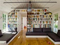 I want a built in book shelf like this!!    The living room of the Helgerson family home near Portland, Ore. The family of four lives in 540 square feet.
