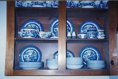 My Blue Willow dinner plates, salad plates, soup bowls and cereal bowls that were used every day were neatly stacked on the bottom shelf for easy access. I stood plates up along the back of the cabinet, creating a pretty back drop. I placed other serving pieces on the second shelf and rarely used cups and saucers along the top.