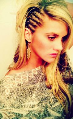 White girl cornrows. Edgy shaved-head look minus the head shaving part :) Section off small rows and use a little Vaseline on your fingertips while braiding. It makes the hair much easier to braid into tiny braids. Start from the top braid and move down, securing all hair not used in the braid into a ponytail to the side. This will help keep stray hairs from getting into the section.