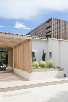 House Architecture Home style design The entrance way has wooden panelling with a few plants e. cactus and bushes. The house has a square and rectangle style. Architecture Design, Contemporary Architecture, Contemporary Design, Exterior Design, Interior And Exterior, Future House, My House, Wooden Panelling, Casa Loft