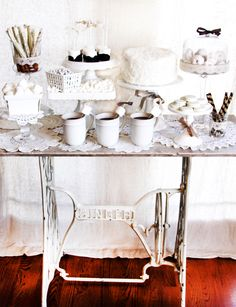 Nice vintage touch to use the Singer sewing machine stand as a base for this dessert display!