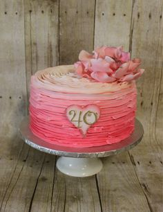 Loving this buttercream ombre cake with sugar flower