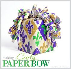 Curly wrapping paper bow:  how to, diy tutorial. A great way to use left over scraps of wrapping paper.