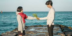 """Tourists flock to seaside filming site of drama 'Goblin' - """"Word has been spreading online that tourists who visit the beach in Jumunjin, a town in northeastern Gangneung City, and specifically the famous walkway that Gong Yoo and Kim Go Eun stood on, a vendor there will provide a bouquet of wildflowers, a scarf, and an umbrella for 1,000₩ each!"""""""